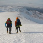 Scottish winter climbing Camo and Dave heading down from the summit of Cairn Gorm